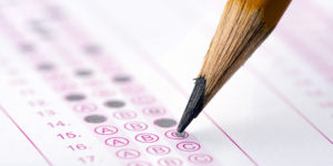 Multiple choice examination form with yellow pencil